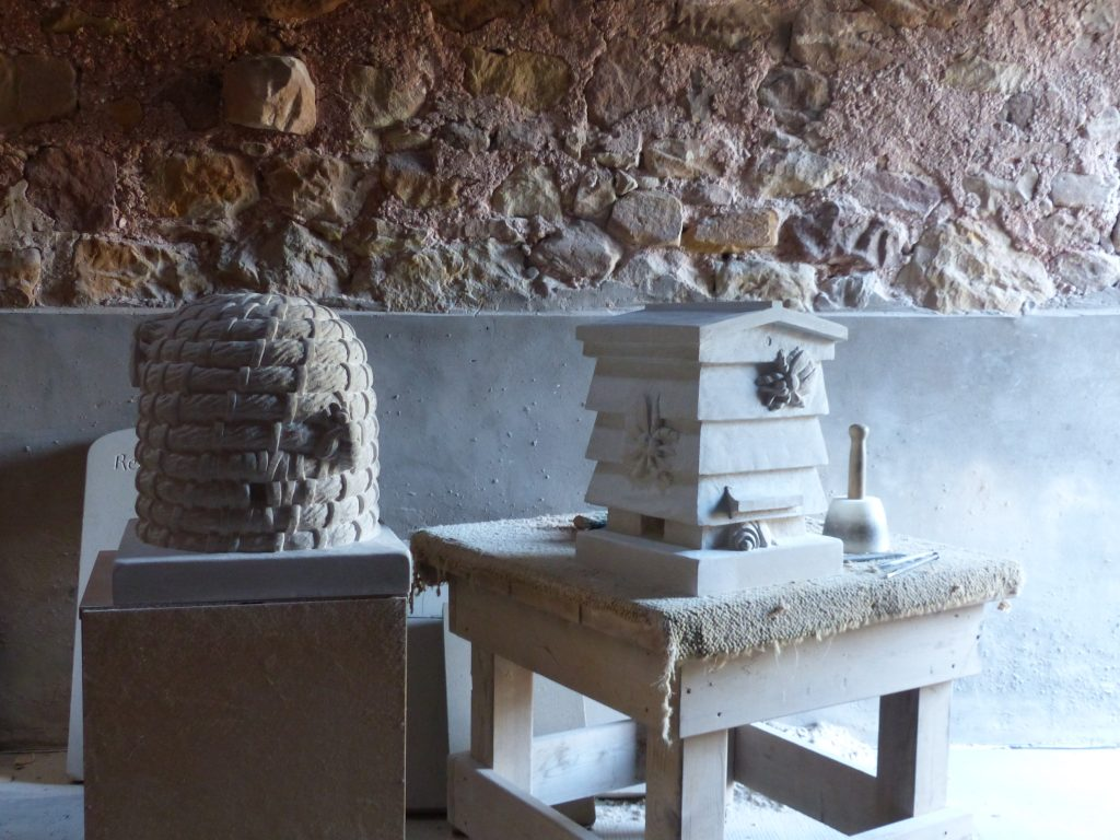 carved stone beehives